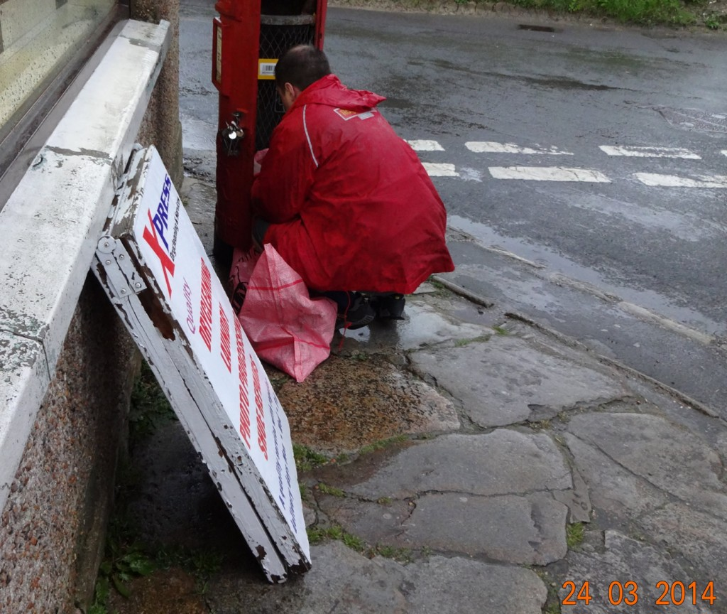 Postman collects the mail