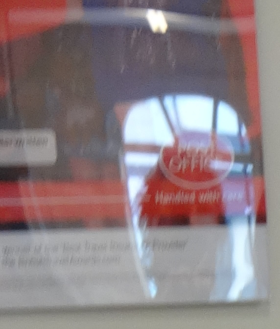 David Smith's reflection in the Post Office poster
